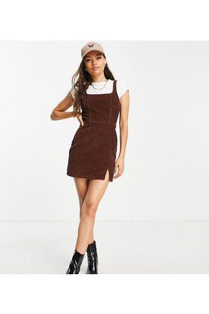 ASOS ASOS DESIGN Petite denim fitted pinny dress in chocolate cord-Brown