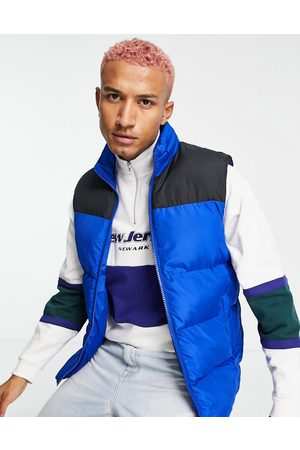 ASOS Puffer gilet with contrast panel and packable hood in cobalt blue