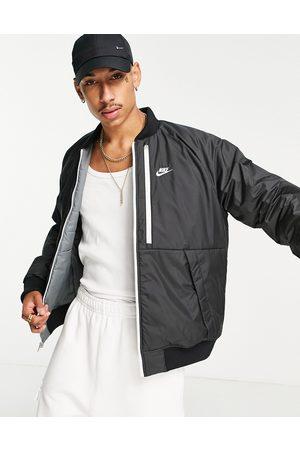 Nike Muži Bombery - Legacy reversible padded bomber jacket in black and grey