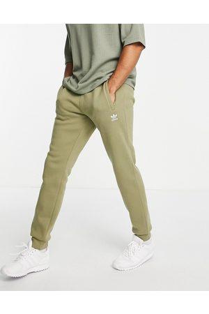 adidas Essentials joggers in khaki-Green