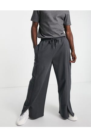 ASOS Muži Tepláky - Co-ord oversized wide leg joggers with front split in washed black