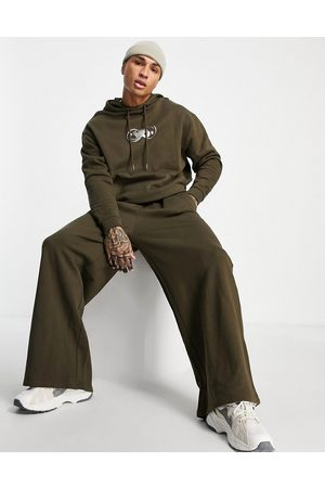 ASOS Oversized tracksuit in brown with metallic chest print