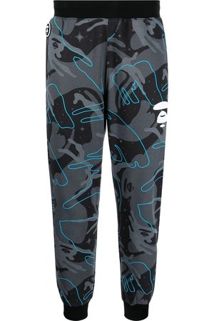 AAPE BY A BATHING APE Graphic-print camo track trousers