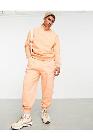 ASOS Co-ord oversized joggers in orange