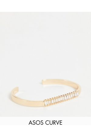 ASOS Ženy Náramky - ASOS DESIGN Curve cuff bracelet with baguette crystal in gold tone