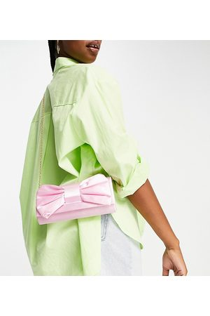 True Decadence Exclusive foldover clutch bag with bow detail in light pink