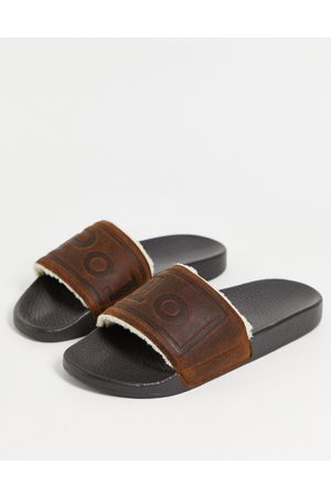 Polo Ralph Lauren Borg & suede slider with logo in tan-Brown