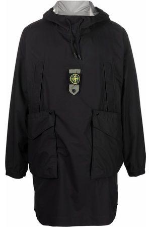 Stone Island Logo-patch drawstring-hood raincoat