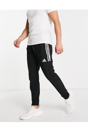 adidas Muži Kalhoty - Adidas Training joggers with three stripes in black