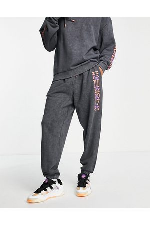 ASOS Co-ord oversized joggers in black acid wash with space prints