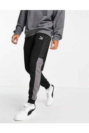 PUMA CLSX joggers in black and grey