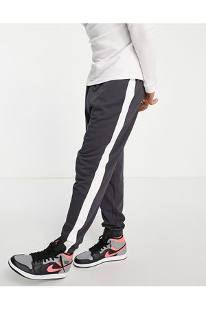 ASOS Oversized joggers with side stripe in washed black-Grey