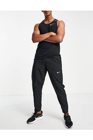 Nike Challenger Dri-FIT woven joggers in black