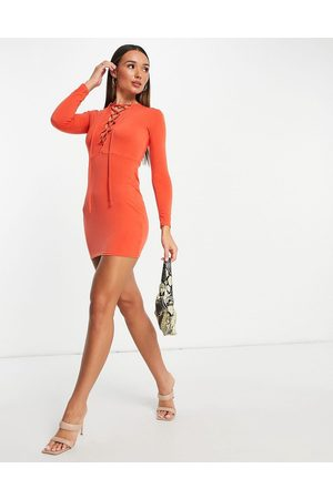 Flounce London Bodycon mini dress with lace up front detail in burnt orange