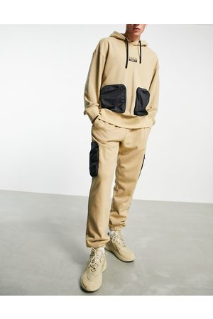 adidas RYV joggers in beige tone with leg pockets-Neutral