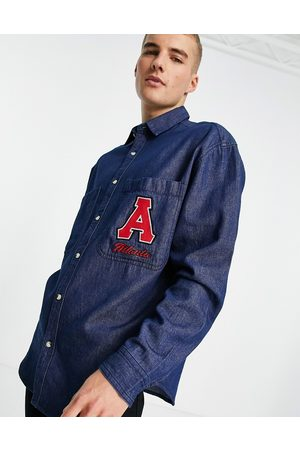 ASOS 90s oversized shirt with all over print and embroidery patch in denim-Blue