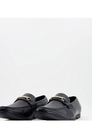 Truffle Collection Wide fit snaffle trim loafers in black faux leather