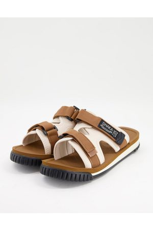 Shaka Chill out sliders in brown