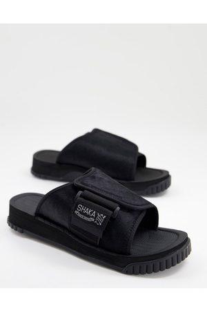 Shaka X-packer sliders in black cowhair