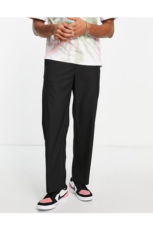Pull&Bear Muži Chino - Wide leg tailored trousers in black