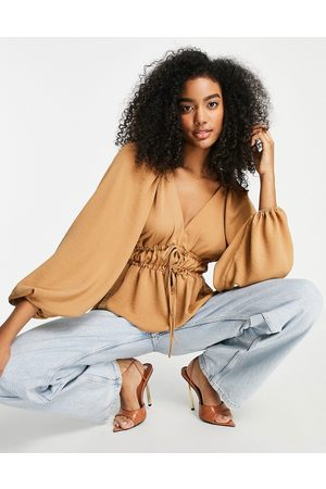 ASOS Long sleeve v neck top with kimono sleeve and tie front in camel-Neutral