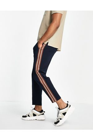 ASOS Tapered fixed hem joggers with pin tucks & side tape in navy