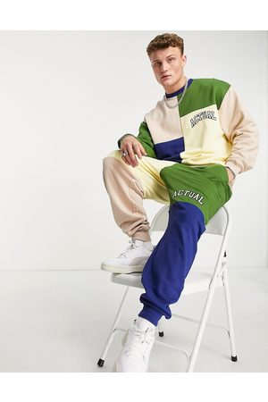 ASOS Muži Tepláky - Co-ord relaxed joggers in colour block with logo print in beige-Neutral