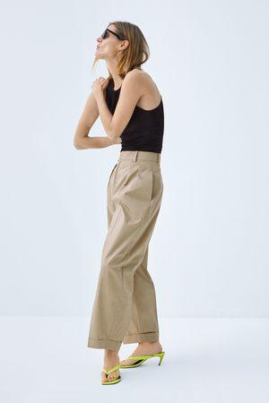 Zara Popelínové kalhoty s puky