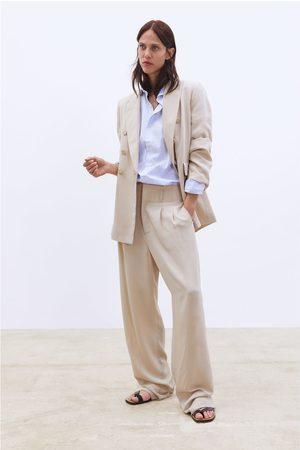 Zara široké kalhoty se záševky