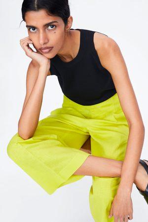 Zara široké kalhoty se záševkem