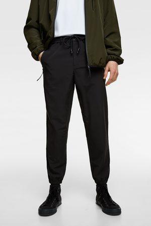 Zara Funkční kalhoty jogger