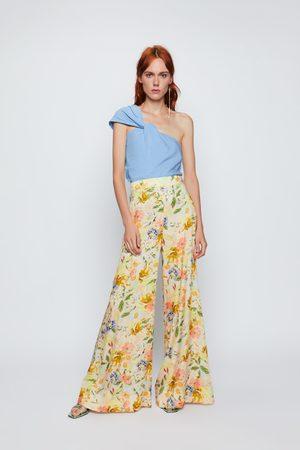 Zara Ženy Široké nohavice - široké kalhoty s květinovým potiskem