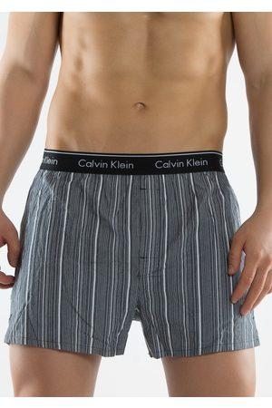 Calvin Klein Pánské trenýrky U1725A černá proužek a kostka L