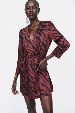 Zara šaty s překřížením a zvířecím potiskem