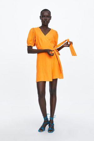 Zara Lněné šaty s překřížením
