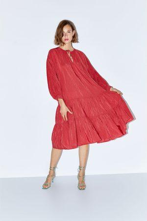 Zara šaty plumeti s volány