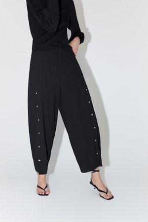 Zara široké kalhoty s aplikacemi