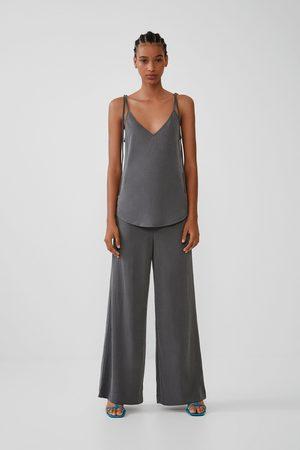 Zara široké splývavé kalhoty